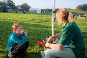 Discussing the whys and wherefores of picking up the poop, Dorset Dogs Su chatting to a young boy at a community event