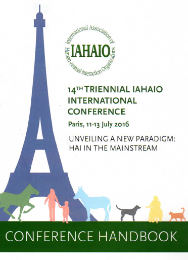 Conference handbook cover with image of Eiffel Tower and silhouettes of people and animals